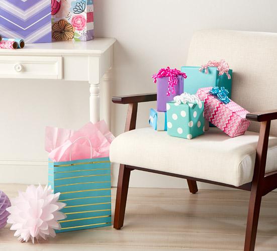 Put their present in a cute, bright gift bag.